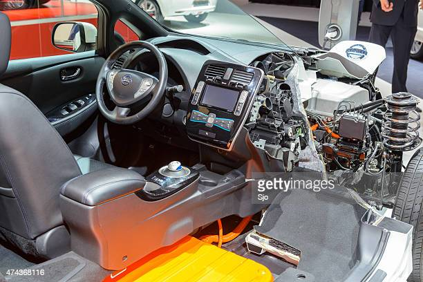 nissan leaf electric vehicle cross section - hybrid vehicle stock photos and pictures