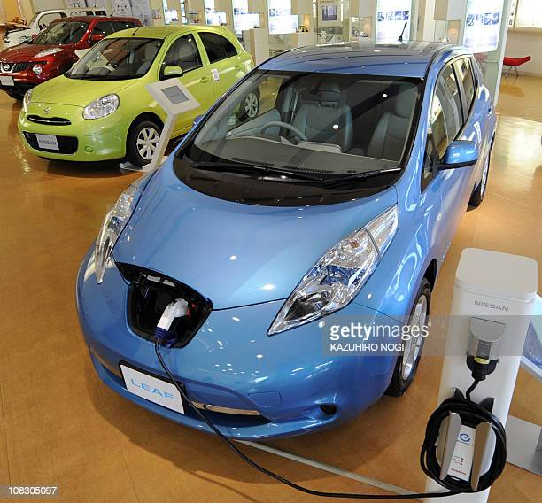 A Nissan Leaf electric vehicle is displayed at a showroom in in the company's Oppama plant in Yokosuka Kanagawa Prefecture on January 25 2011 The...