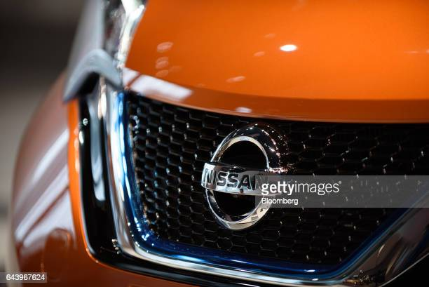 A Nissan Motor Co badge is seen on a Note vehicle at a company showroom in Yokohama Japan on Thursday Feb 23 2017 Carlos Ghosn chairman of Nissan...