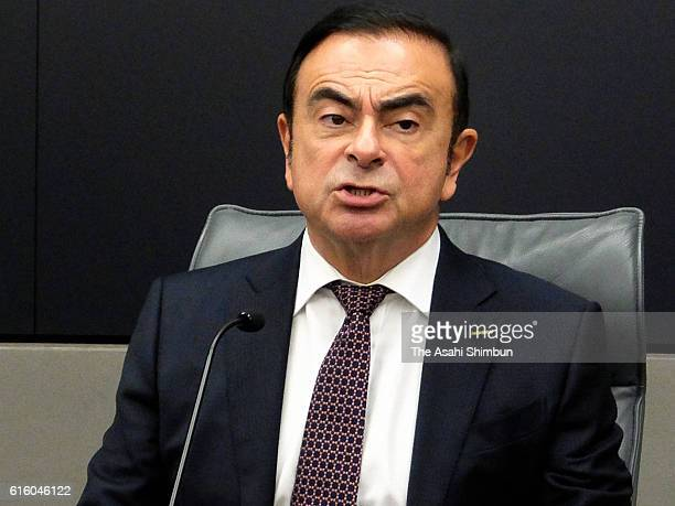 Nissan Motor Co CEO and Chairman and Mitsubishi Motors Chairman Carlos Ghosn speaks during an interview at the Nissan headquarters on October 21 2016...