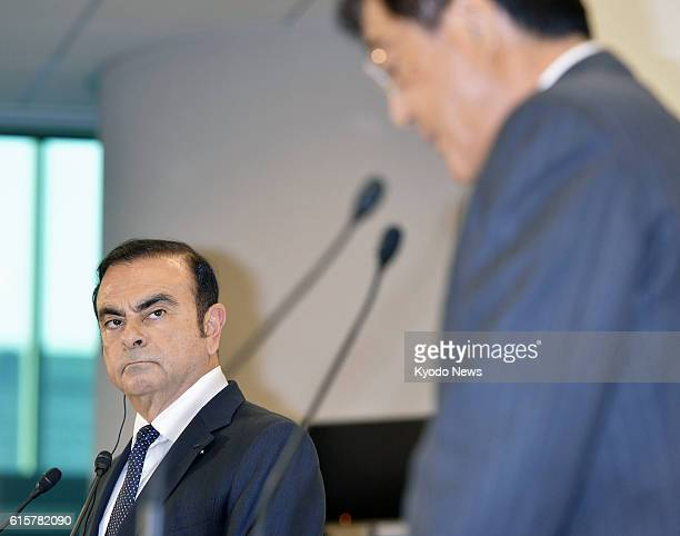 Nissan Motor Co Chief Executive Officer Carlos Ghosn and Mitsubishi Motors Corp Chairman and President Osamu Masuko attend a press conference in...