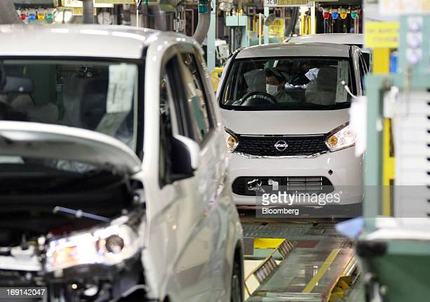 Nissan Motor Co DAYZ minicars go through the inspection area on the production line of the Mitsubishi Motors Corp Mizushima plant in Kurashiki City...