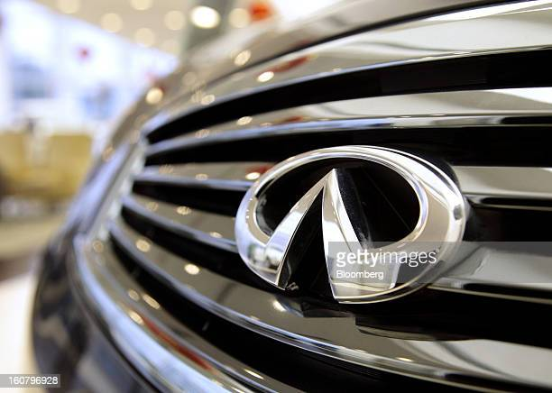 A Nissan Motor Co Infiniti logo is displayed on a vehicle at a Shanghai Dongchang Infiniti Auto Sales and Service Co dealership in Shanghai China on...