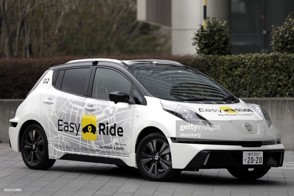 A Nissan Motor Co. Leaf electric operated by the 'Easy Ride' robot taxi service, a joint development between Nissan and DeNA Co., is seen during a demonstration in Yokohama, Japan, on Friday, Feb. 23, 2018. The service, which allows the public to use a smartphone app to book 15-minute rides, is scheduled to launch on March 5 for two weeks in Yokohama. Photographer: Kiyoshi Ota/Bloomberg via Getty Images