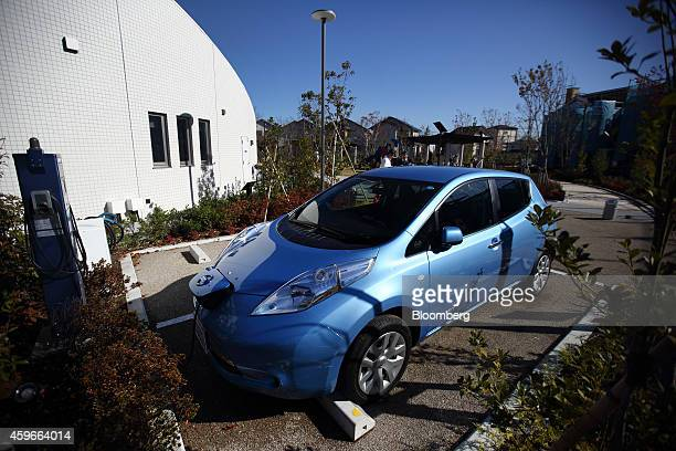 Nissan Motor Co. Leaf electric vehicle, for car sharing service, is parked at the Fujisawa Sustainable Smart Town, developed by a consortium led by...