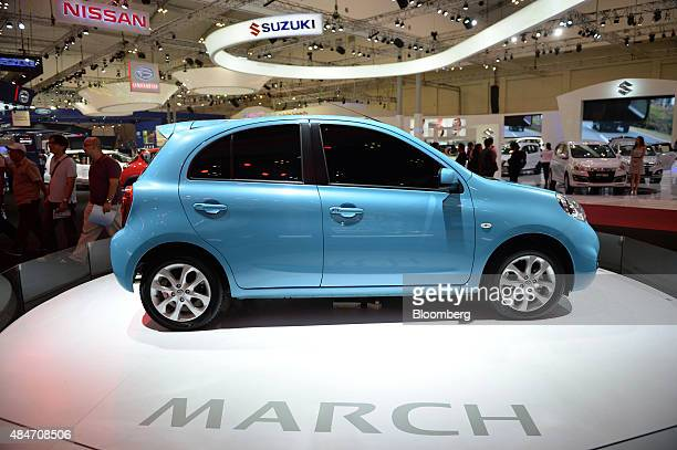 A Nissan Motor Co March subcompact vehicle stands on display at the Gaikindo Indonesia International Auto Show in Jakarta Indonesia on Friday Aug 21...