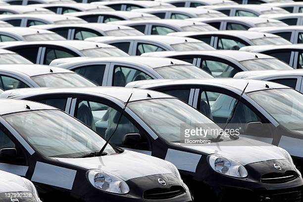 Nissan Motor Co March vehicles wait for shipment in a lot at the company's Oppama wharf in Yokosuka City Kanagawa Prefecture Japan on Monday Jan 30...