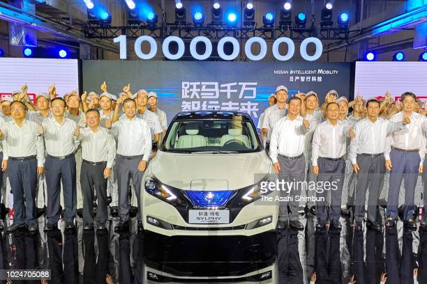 Nissan Motor Co President Hiroto Saikawa and executives pose to mark the 10 millionth production in China on August 27 2018 in Guangzhou China