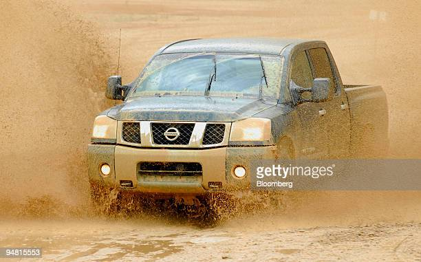 Nissan Motor Co Titan pickup truck is pictured driving on an offroad course Thursday March 30 2006 in Bridgeport Texas