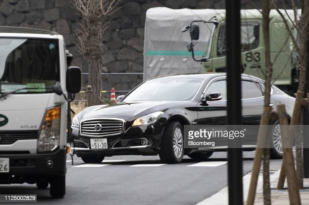 A Nissan Motor Co vehicle carrying JeanDominique Senard chairman of Renault SA approaches the Tokyo Kaikan building ahead of a meeting with...