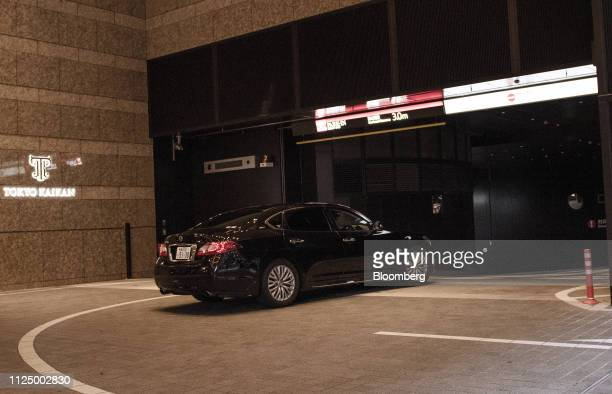 A Nissan Motor Co vehicle carrying JeanDominique Senard chairman of Renault SA enters a parking lot at the Tokyo Kaikan building ahead of a meeting...