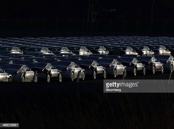 Nissan Motor Co vehicles bound for shipment sit in a lot at a port in Hitachi City Ibaraki Prefecture Japan on Friday Feb 7 2014 Nissan Japan's...