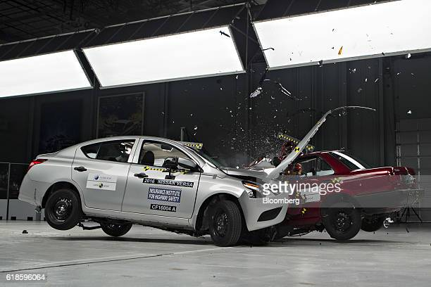 Nissan Motor Co Versa left is test crashed into a 2015 Nissan Motor Co Tsuru at a combined closing speed of 80mph inside Insurance Institute for...