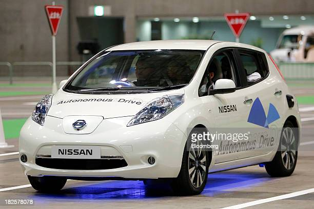 Nissan Motor Co's Autonomous Drive Leaf electric vehicle is driven for a demonstration ride at the CEATEC Japan 2013 exhibition in Chiba Japan on...