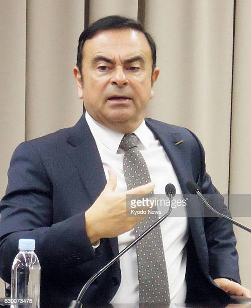 Nissan Motor Co's top executive Carlos Ghosn gives an interview to several media organizations including Kyodo News on Dec 16 at the automaker's...