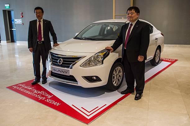 Nissan Motor executives Kenji Naito (L) and Yutaka Sanada pose with ...
