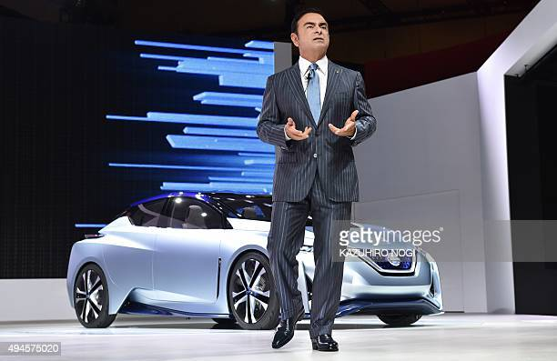Nissan Motor President Carlos Ghosn delivers a speech in front of the Nissan IDS Concept during a press briefing at the Tokyo Motor Show 2015 on...