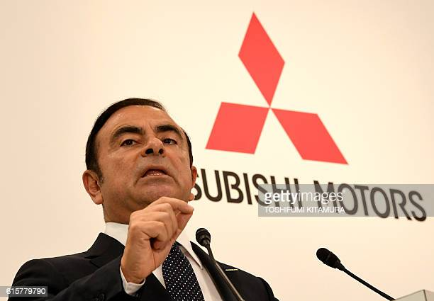 Nissan Motors chairman and CEO Carlos Ghosn answers a question during a joint press conference with Mitsubishi Motors Corporation president and CEO...