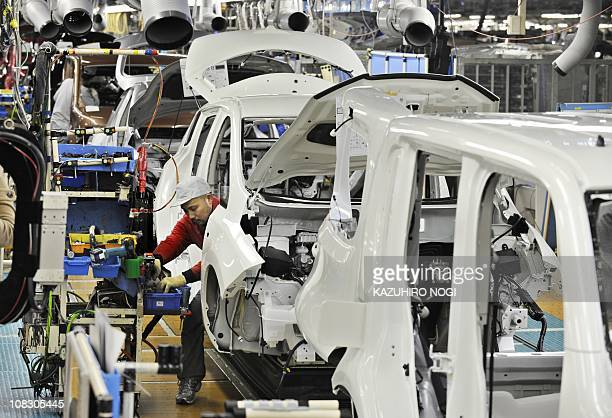 Nissan Motor's workers installs components into a Leaf electric vehicle on the assembly line at the company's Oppama plant in Yokosuka Kanagawa...