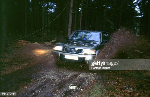 Nissan Patrol GR driving through mud 2000
