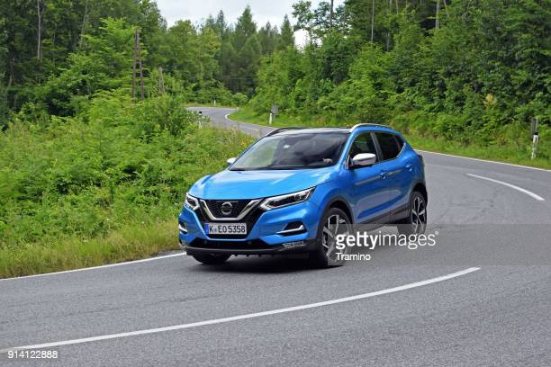 nissan qashqai in motion - nissan qashqai stock pictures, royalty-free photos & images