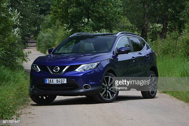 nissan qashqai on the road - nissan qashqai stock pictures, royalty-free photos & images