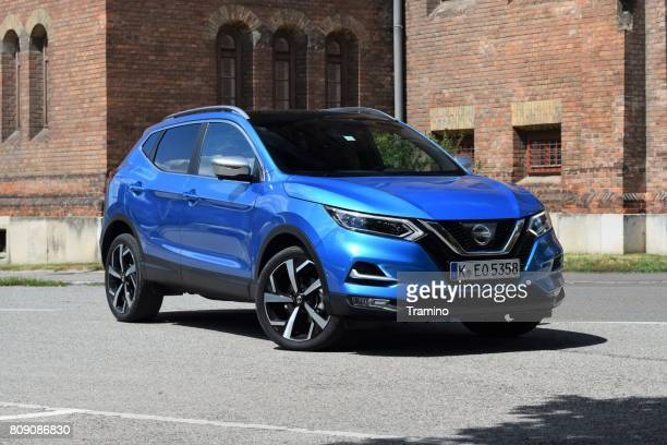 nissan qashqai on the street - nissan qashqai stock pictures, royalty-free photos & images