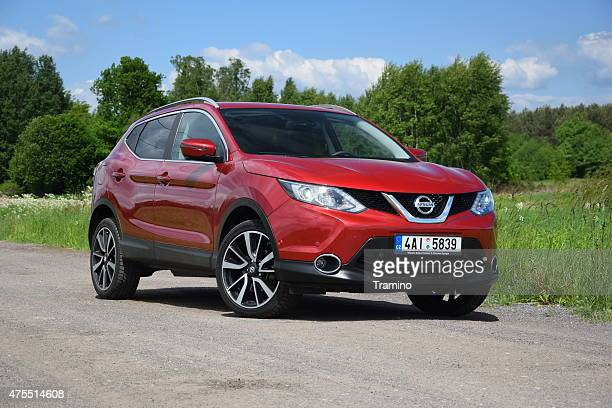 nissan qashqai on the unmade road - nissan qashqai stock pictures, royalty-free photos & images