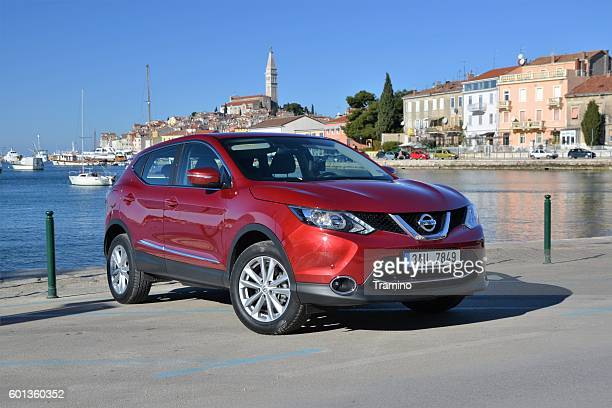 nissan qashqai stopped on the street - nissan qashqai stock pictures, royalty-free photos & images