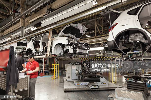CONTENT] Nissan Qashqai's pass by on the production line at Nissan's Sunderland plant Sunderland UK In the foreground before a control panel stands a...