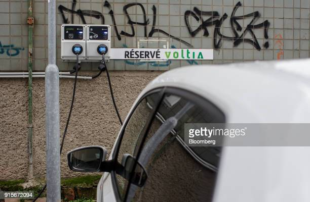 A Nissan Voltia env200 electric vehicle charges itself at a GreenWay Infrastructure sro electric vehicle charging station in Bratislava Slovakia on...