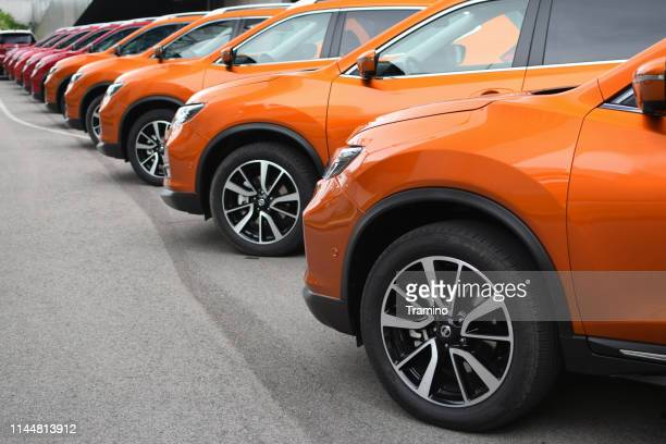 nissan x-trail vehicles on the parking - nissan stock pictures, royalty-free photos & images