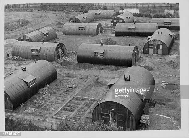 Nissen hut used as emergency housing for families on an old sports ground following World War Two Germany 1946
