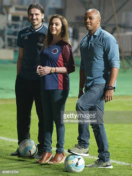Nita Ambani director of the Indian Super League poses for photographs with former Manchester United players Quinton Fortune and Bojan Djordjic during...
