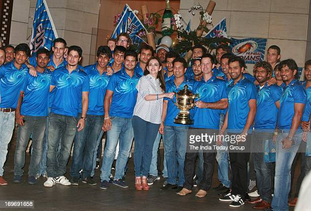 Nita Ambani poses with the Mumbai Indians team at the party hosted by her to celebrate her team's victory in IPL finals