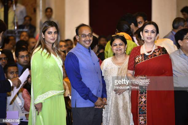 Nita Ambani with her daughter Isha and Sports Minister Vijay Goel with his wife at a function at Rashtrapati Bhawan on the occasion of National...