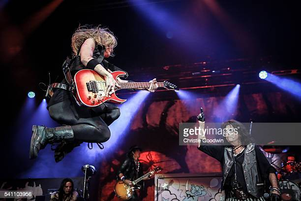 Nita Strauss and Alice Cooper perform on stage at The O2 Arena on June 18 2016 in London England