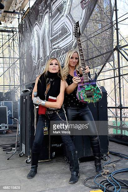 Nita Strauss and Lorraine Lewis of Femme Fatale backstage during the 2014 M3 Rock Festival at Merriweather Post Pavillion on April 26 2014 in...