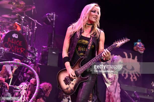 """Nita Strauss of Alice Cooper's band performs during his """"Paranormal"""" tour at City National Civic on August 14, 2018 in San Jose, California."""