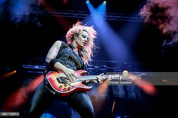 Nita Strauss of Alice Cooper's band performs on stage at The O2 Arena on June 18 2016 in London England