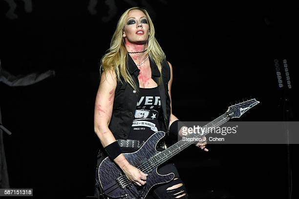 Nita Strauss performs with Alice Cooper at The Louisville Palace on August 7, 2016 in Louisville, Kentucky.
