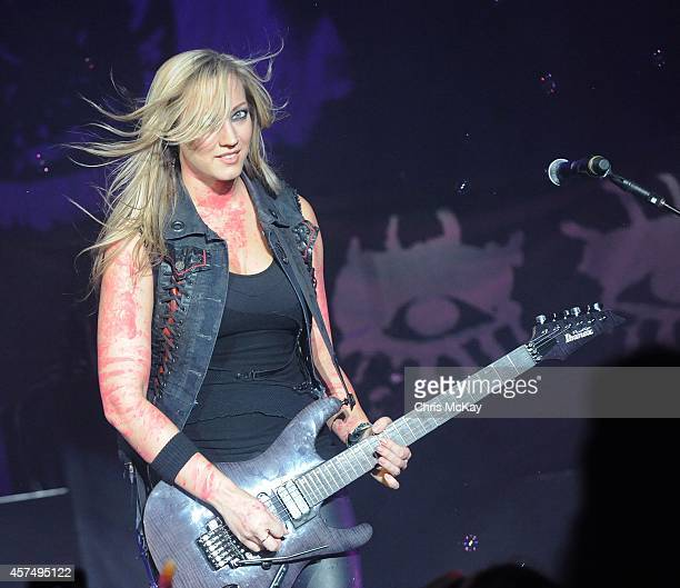 Nita Strauss performs with Alice Cooper at The Macon Centreplex on October 18 2014 in Macon Georgia