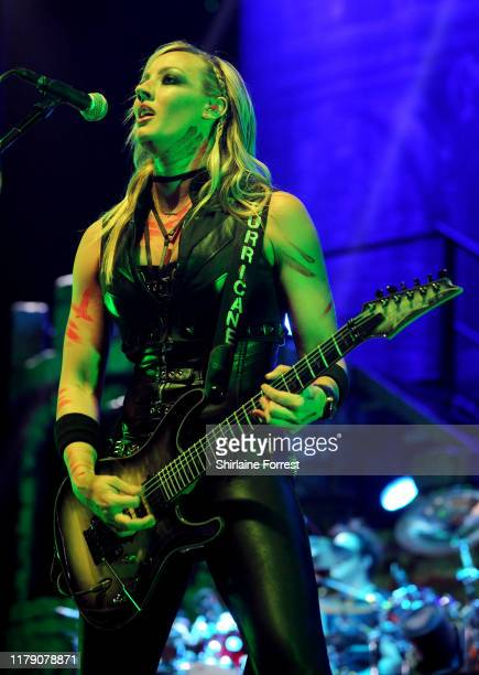 Nita Strauss performs with Alice Cooper on stage at Manchester Arena on October 04, 2019 in Manchester, England.