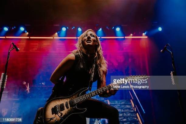 Nita Strauss performs with Alice Cooper on stage at Motorpoint Arena on October 12, 2019 in Cardiff, Wales.