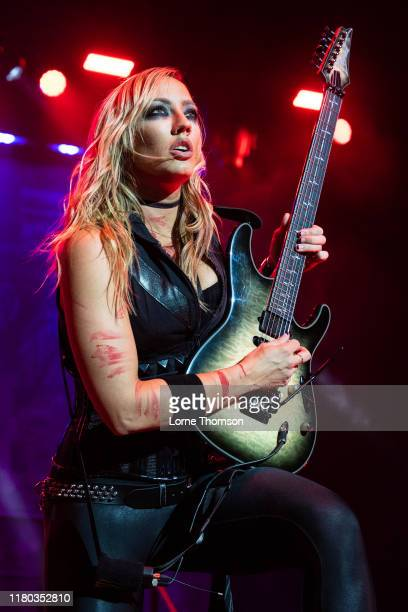 Nita Strauss performs with Alice Cooper on stage at The O2 Arena on October 10, 2019 in London, England.
