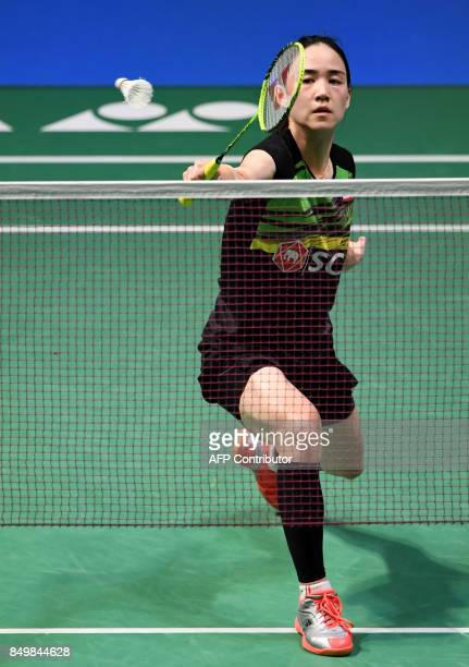 Nitchaon Jindapol of Thailand hits a return to Beiwen Zhang of the US during their women's singles first round match at Japan Open Badminton...