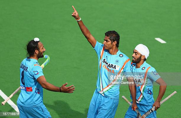 Nithin Thimmaiah of India celebrates scoring his goal during the match between India and Belgium on day four of the 2012 Champions Trophy at the...