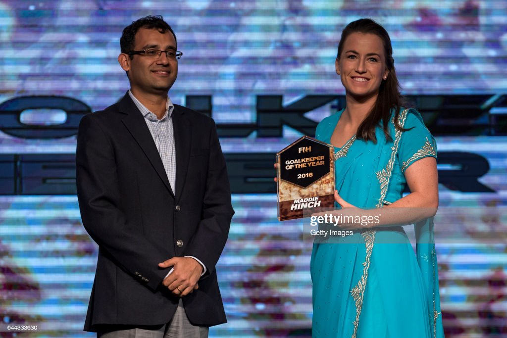 Nitin Kukreja [L] of Star Sports presents the FIH Female Goal Keeper of the Year award to Maddie Hinch [R] of England and Great Britain during the...