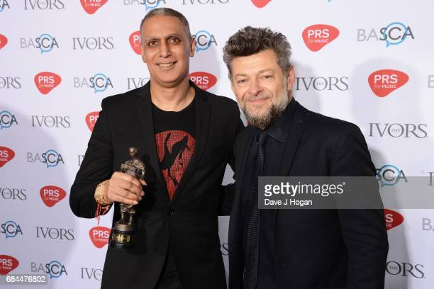 Nitin Sawhney and Andy Serkis pose in the winners room with the Lifetime Achievement award at the Ivor Novello Awards at Grosvenor House on May 18...