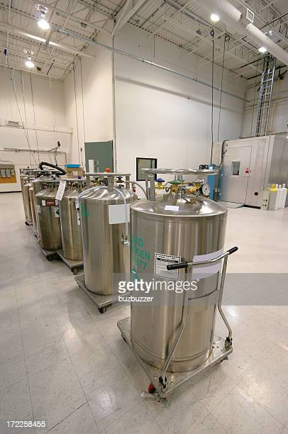 nitrogen containers inside an industrial building - cylinder stock pictures, royalty-free photos & images